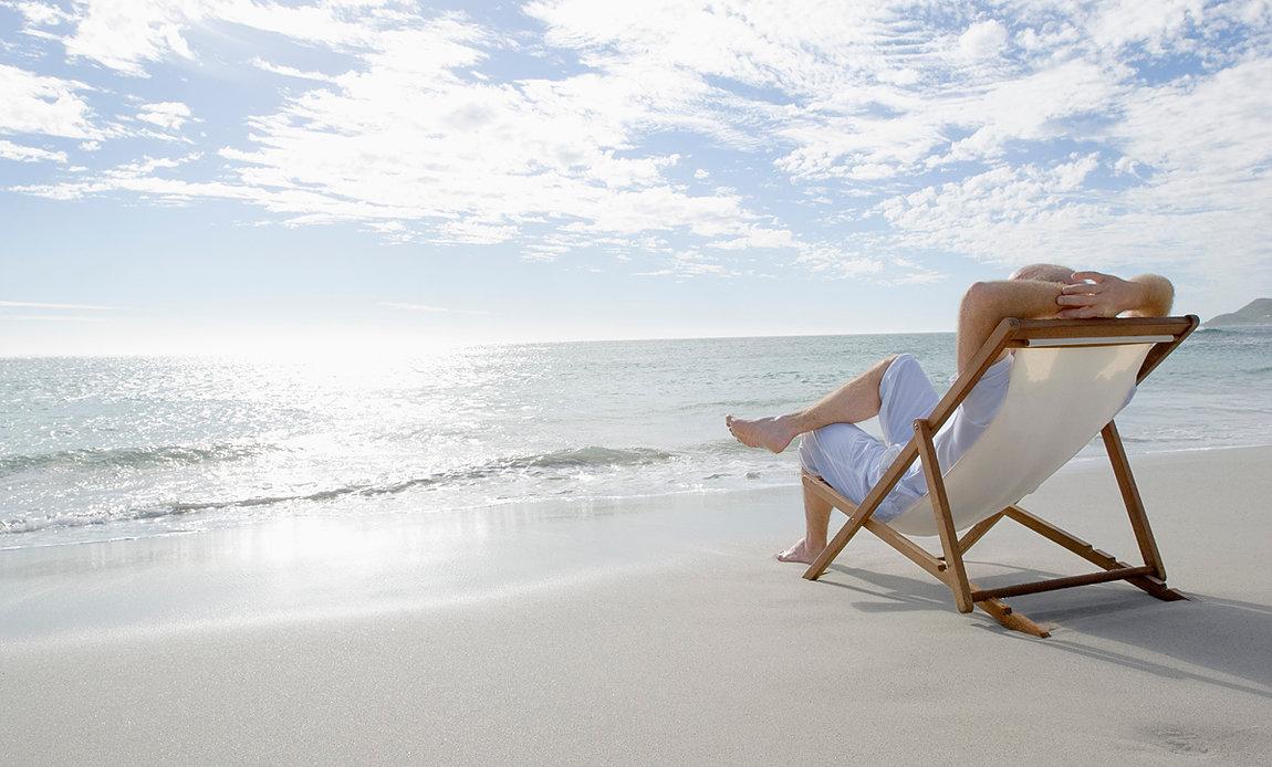 man on chair at beach